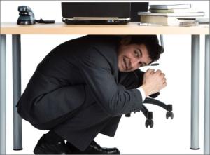 Polotician-Hiding-Under-Desk
